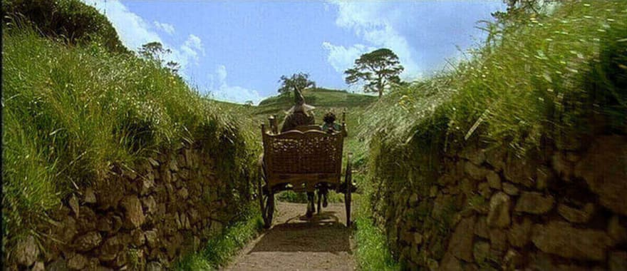 image gandalf entering hobbiton from the lord or rings movie