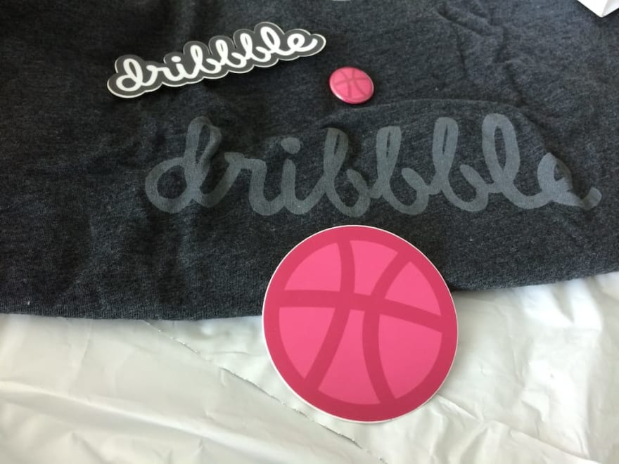 The Dribbble t-shirt, with stickers