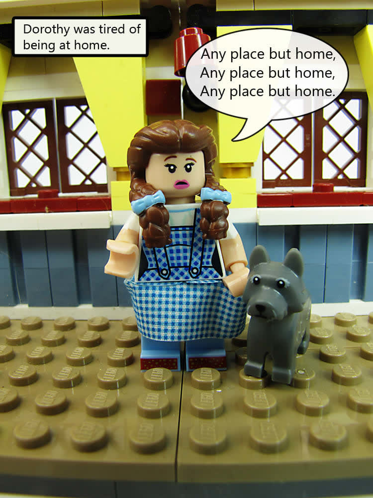 """LEGO Dorothy standing with toto. caption:Dorothy was tired of being at home. She says """"anyplace but home. anyplace but home. Anyplace but home."""""""