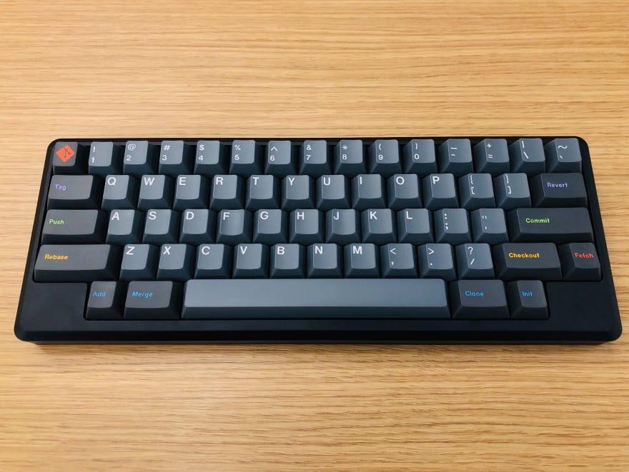 Tokyo60 HHKB-layout keyboard with GMK Oblivion keycaps on a wooden desk
