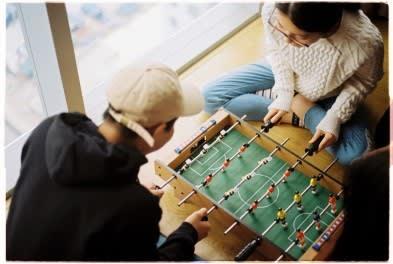 Playing foosball