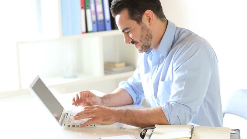 Guy happy reading from a laptop