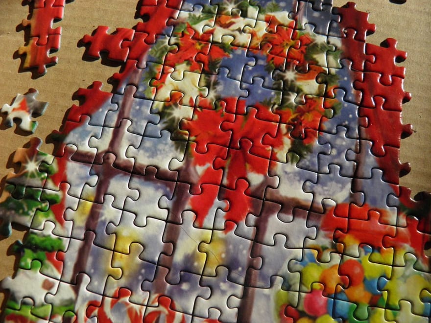 A Christmas themed jigsaw puzzle, partially complete.