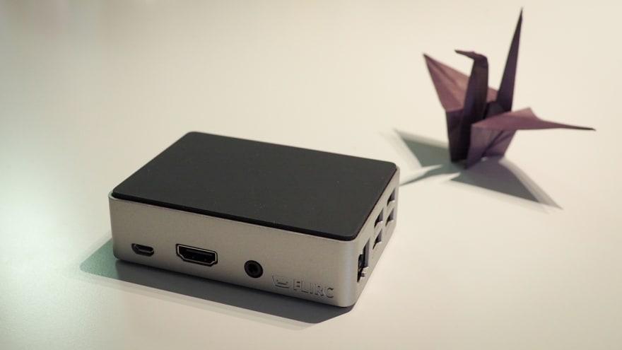 Raspberry Pi 3B in Flirc aluminum case and a purple origami crane