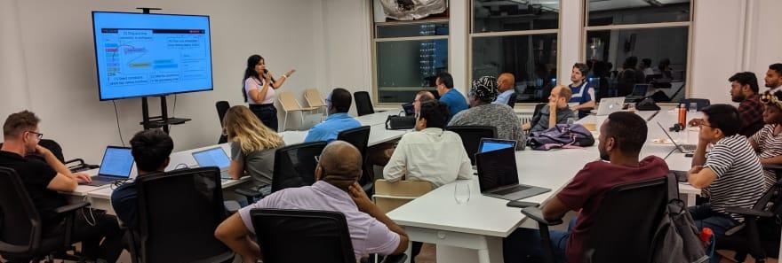 Pooja presenting at a meetup