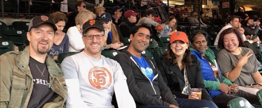 Upkar and the team at a Giants baseball game