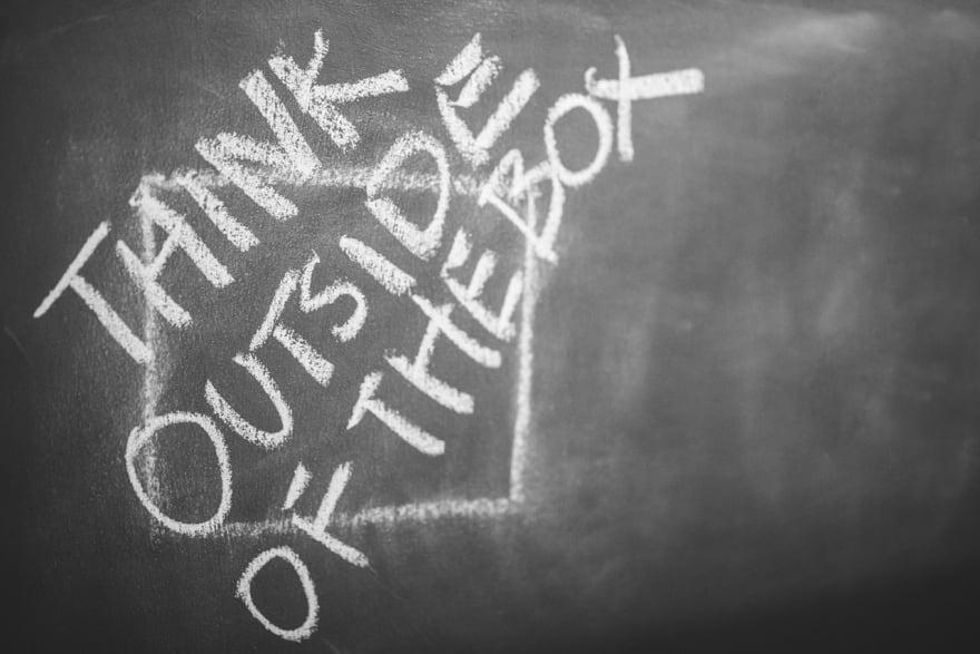 Think outside the box written on a blackboard