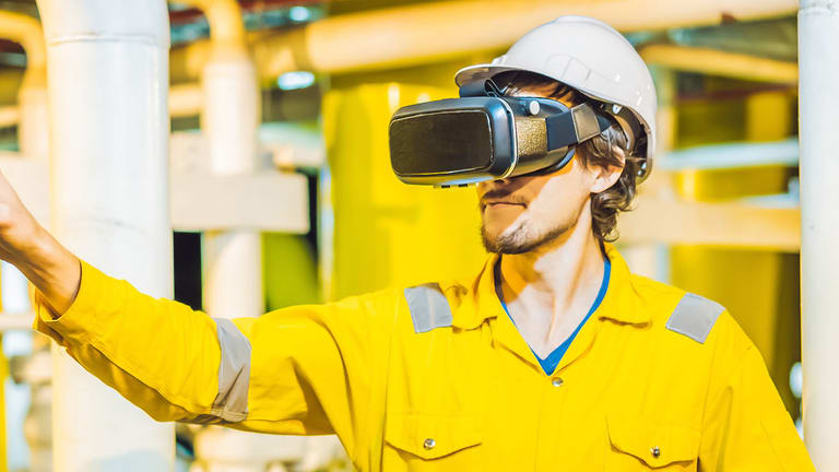 A man wearing VR headsets to use VR for hazard awareness.