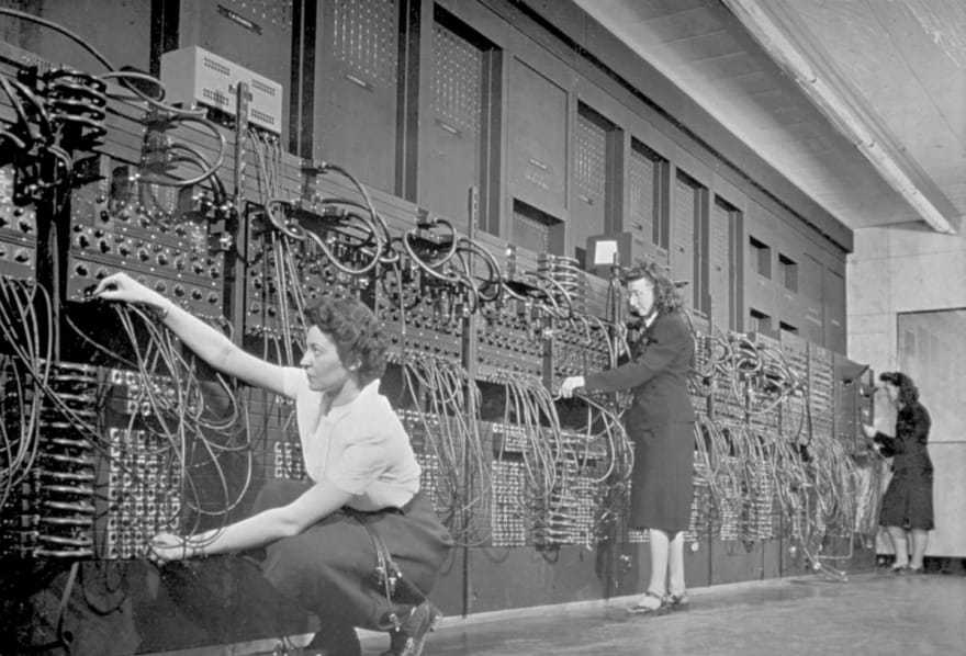 Women working on the first computer in the world