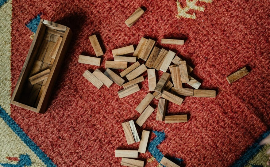 A pile of wooden blocks on the floor