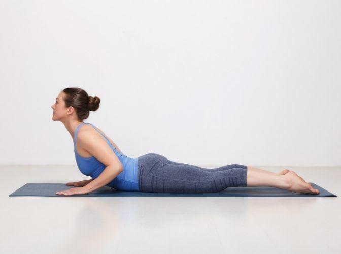 woman in half cobra pose