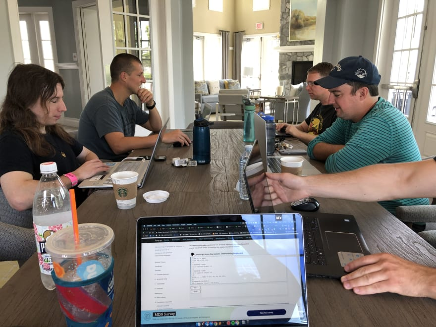 Image of MetroWest freeCodeCamp meetup with several attendees working on their laptops