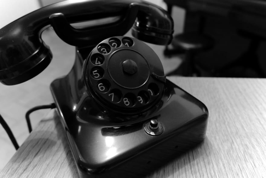 A rotary phone with a dial