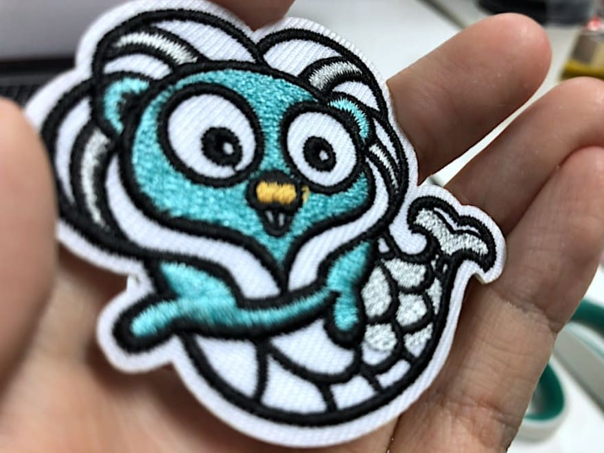 Gophercon Singapore mascot embroidered stickers close-up, from Shenzen Xinbaoyuan Weaving