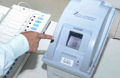 The VVPAT machine printing out receipts.