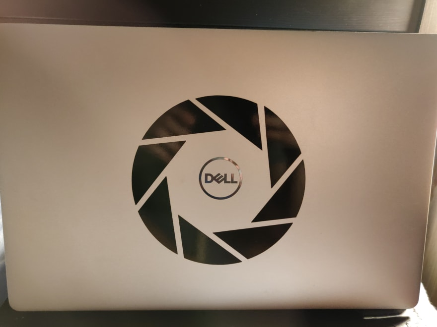 Laptop with Aperture Science sticker placed in the centre