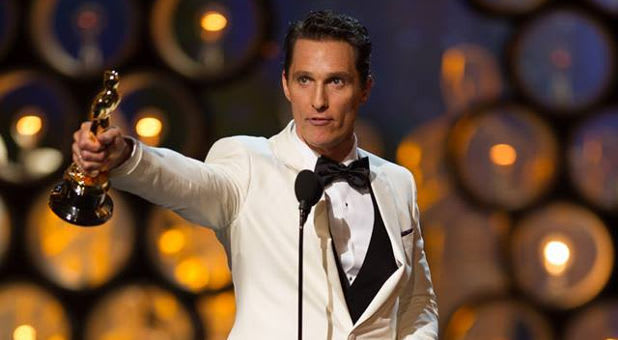 Matthew McConaughey picking up the Academy Award (Oscar)