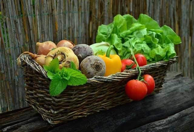 A wicker basket full of fresh fruit