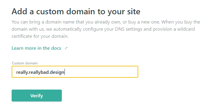"Netlify add custom domain wizard, step 1. A textbox for the domain name and a ""Verify"" button are shown. ""really.reallybad.design"" is typed in the box."