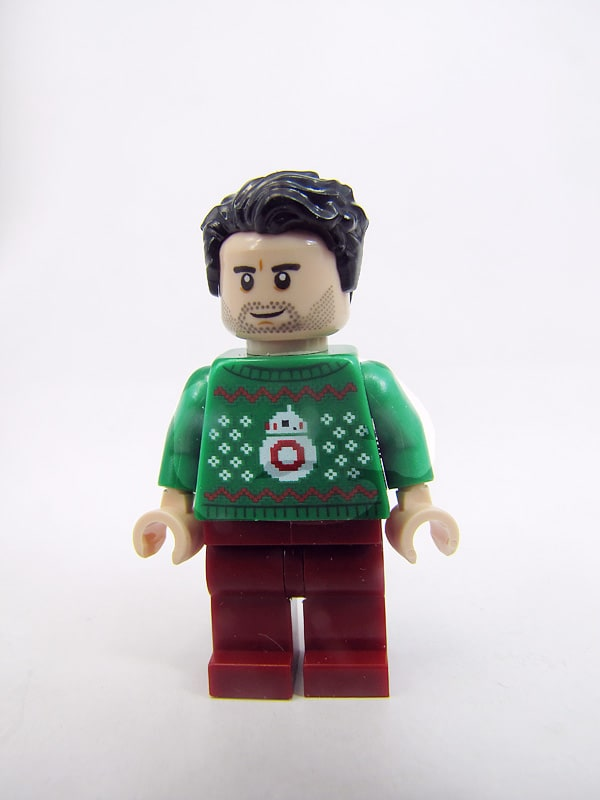 Poe dameron wearing a gaudy sweater. It has a pic of bb-8 on it.