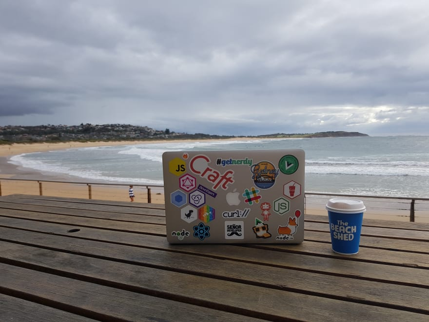 "My laptop and its stickers, and also my ""home office""!"