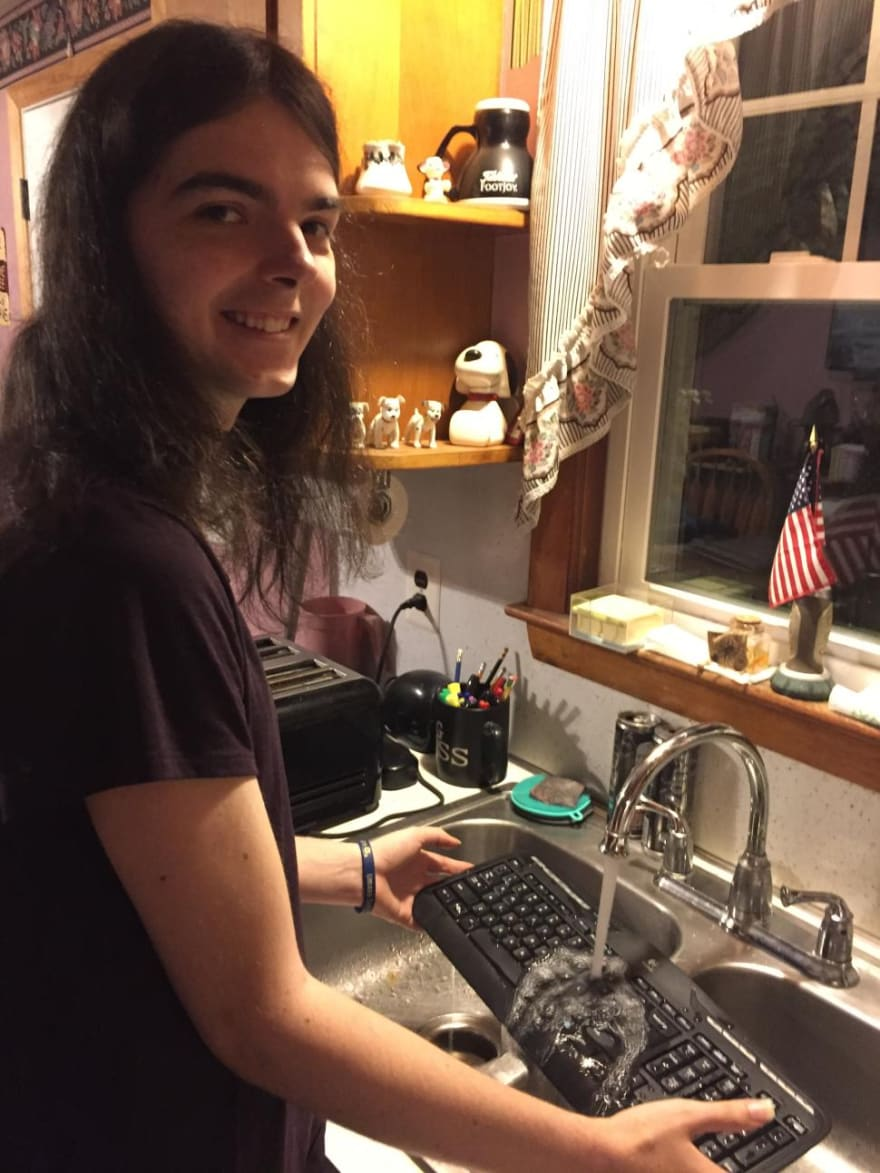 photo of meghan washing a keyboard in the sink