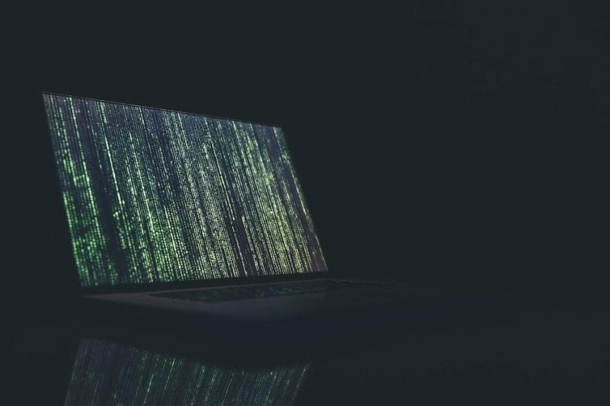 Matrix style text waterfall on a laptop
