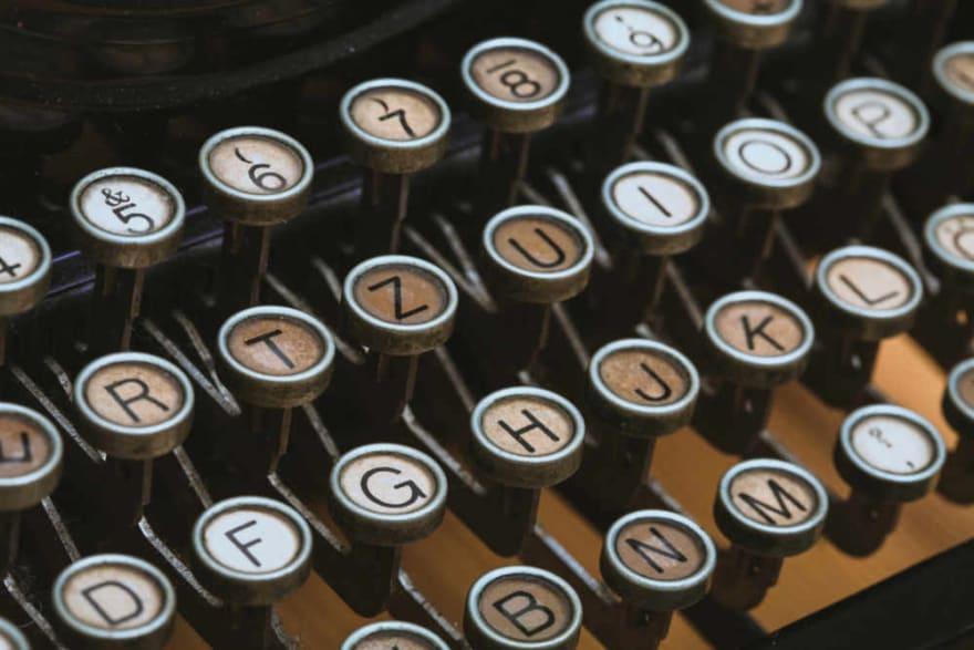 Typewriter key arms