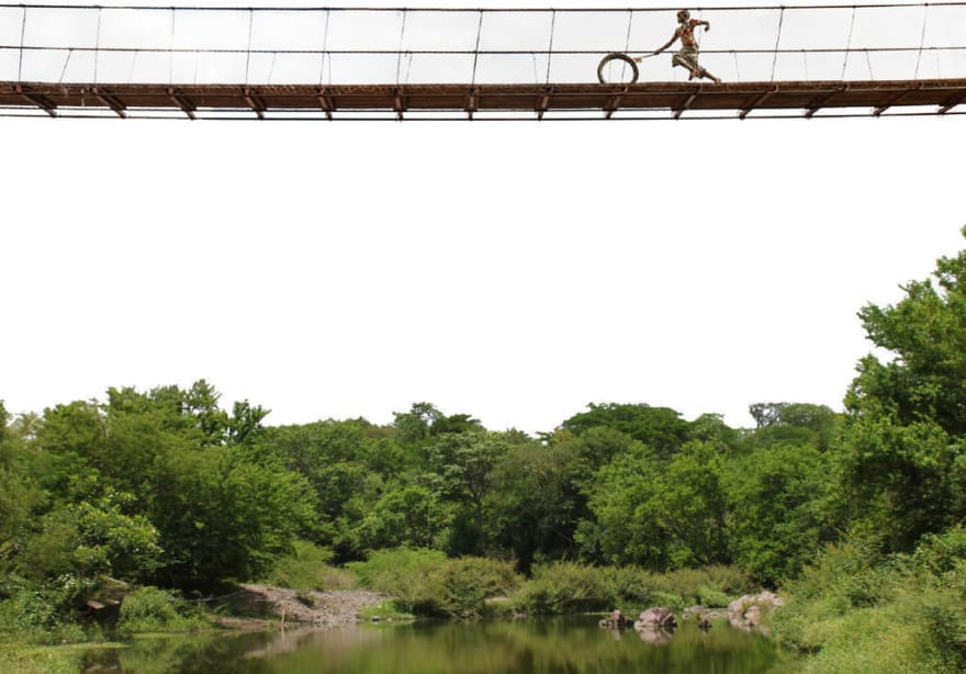 Bridge picture with a kid running with spinning wheel
