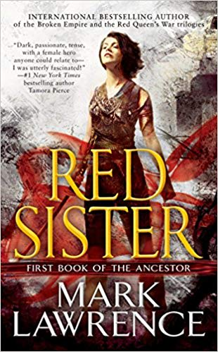 The front cover of Red Sister, with Nona taking most of the cover holding a sword in a defying pose.