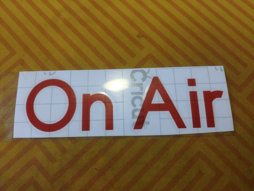 "Text ""On Air"" cut out of vinyl"
