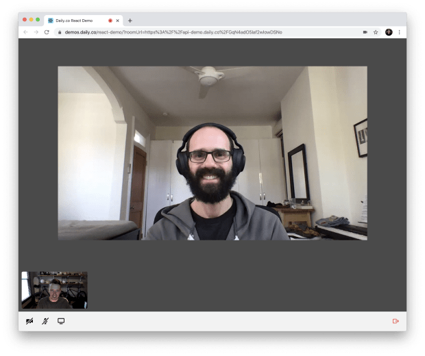 Two people smiling in a video call in the React demo app