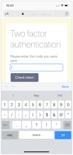 A web page shown in iOS Safari with a two factor authentication prompt. This time the keyboard includes numbers and symbols.