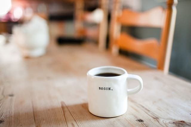 Coffee cup with text 'Begin.'