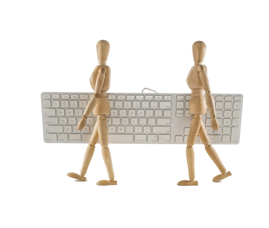 Two modeling figures carrying a keyboard together