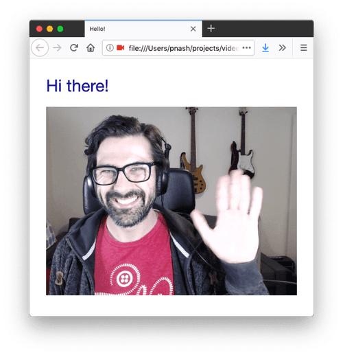 Me on screen in this app, waving and smiling.