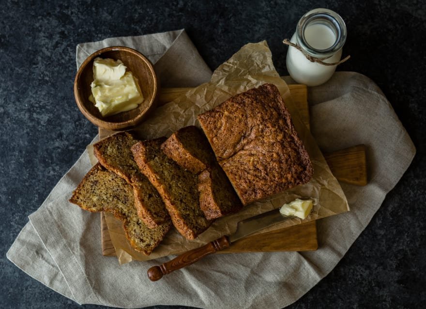 Bread beside butter and milk | Photo by Whitney Wright on Unsplash