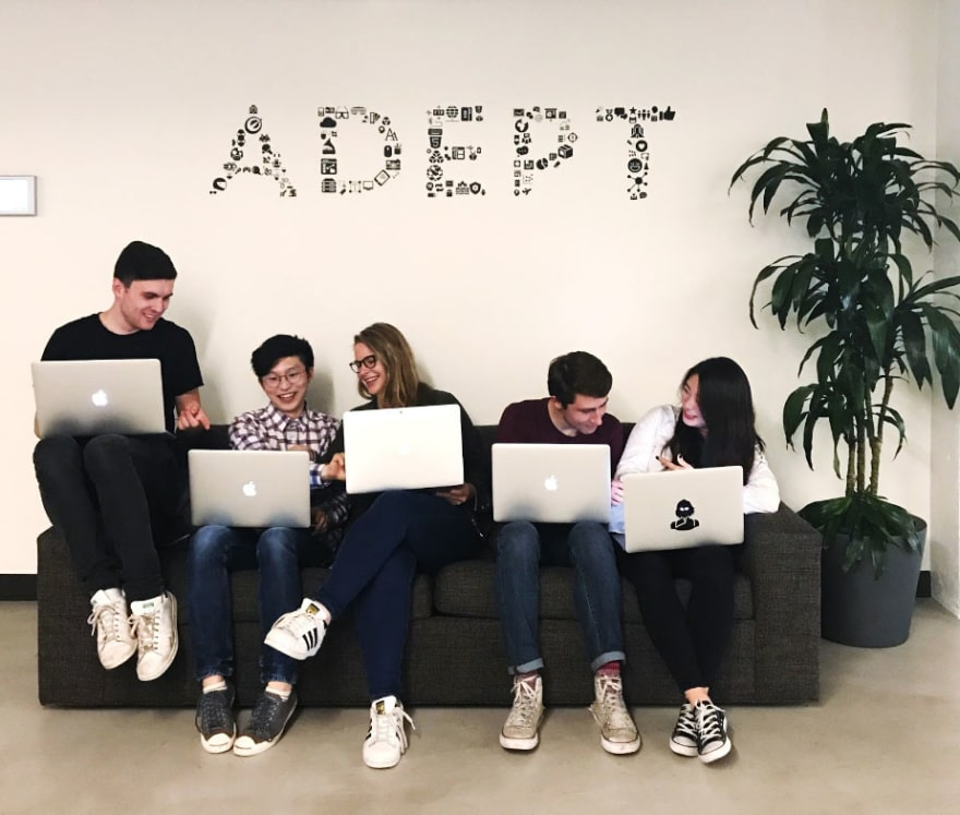 Optimizely interns sit on the 'intern' couch