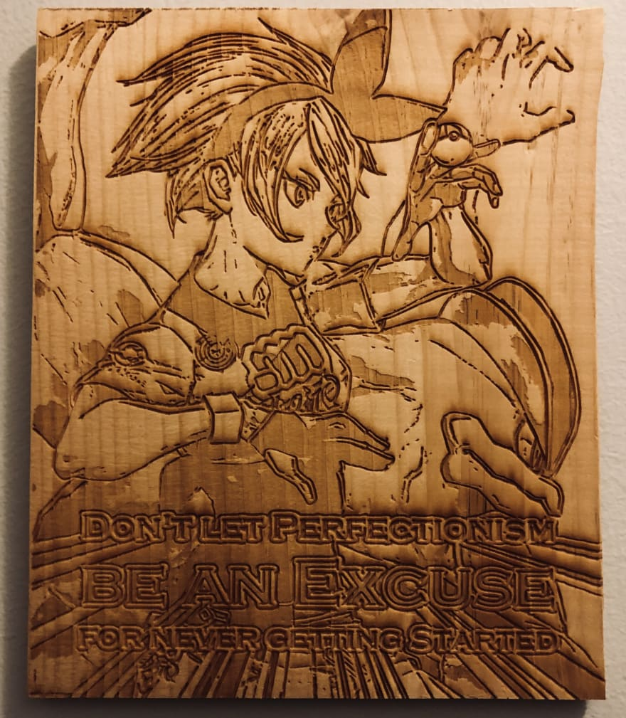 A piece of wood with the quote 'don't let perfectionism be an excuse for never getting started' engraved into it.