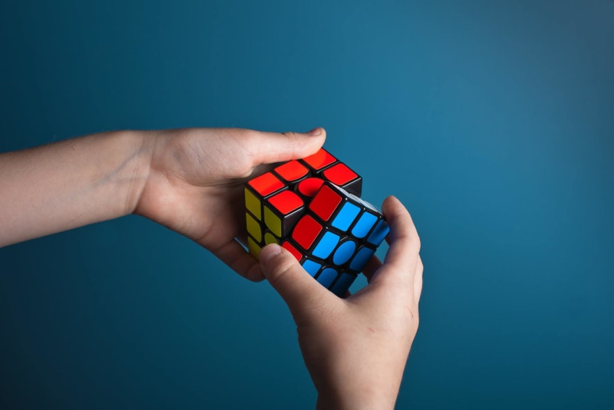 Image that symbolizes problem-solving, a person holding a rubik cube