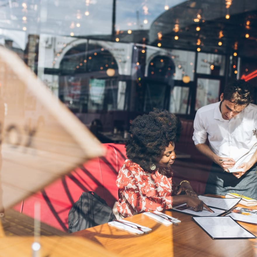 Woman ordering food in a restaurant