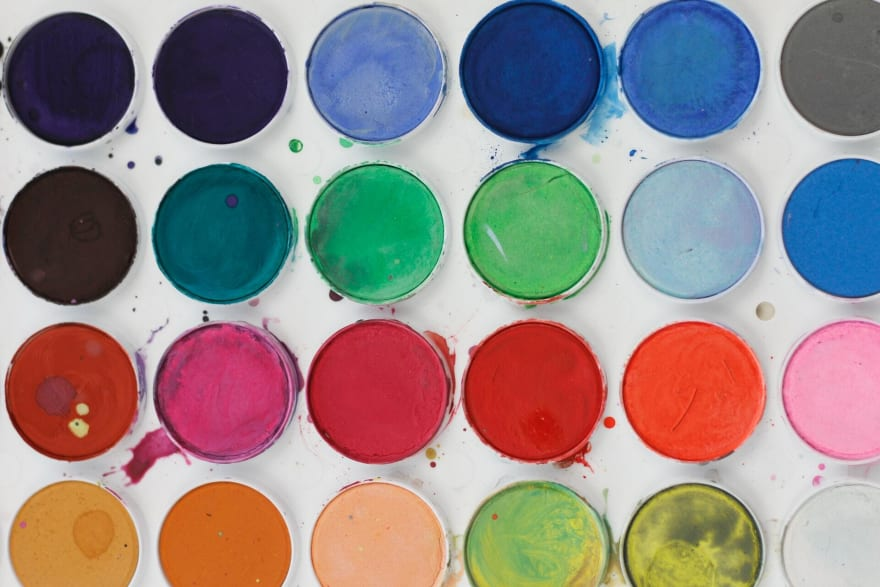 Buckets of paint in neatly lined up