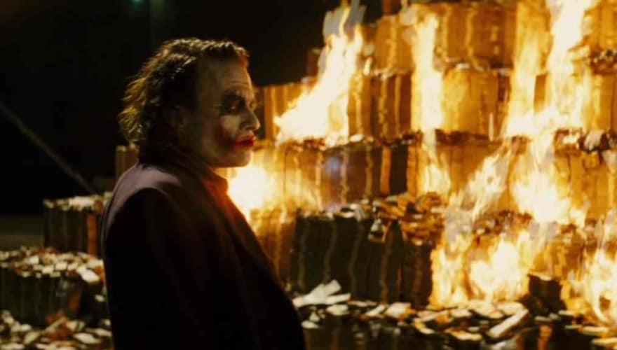 Joker burning a huge pile of money