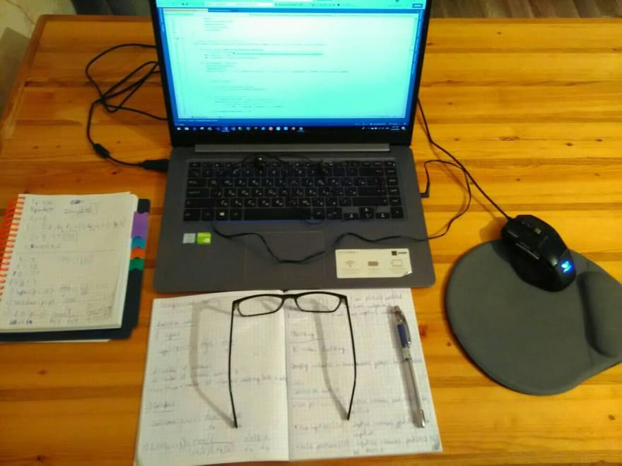 Laptop with glasses and headphones