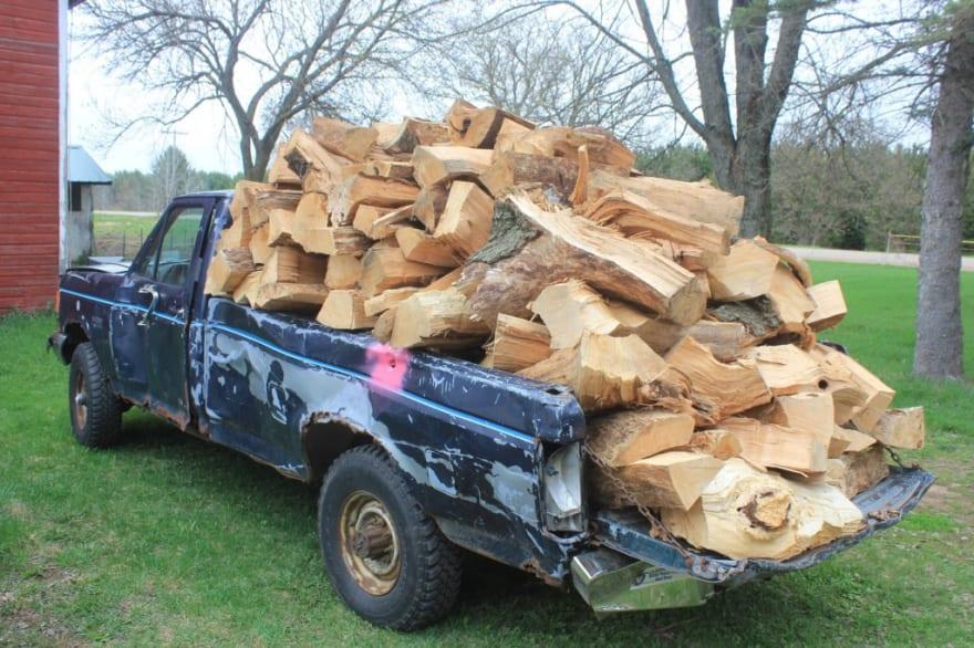 Image of pickup truck full of logs