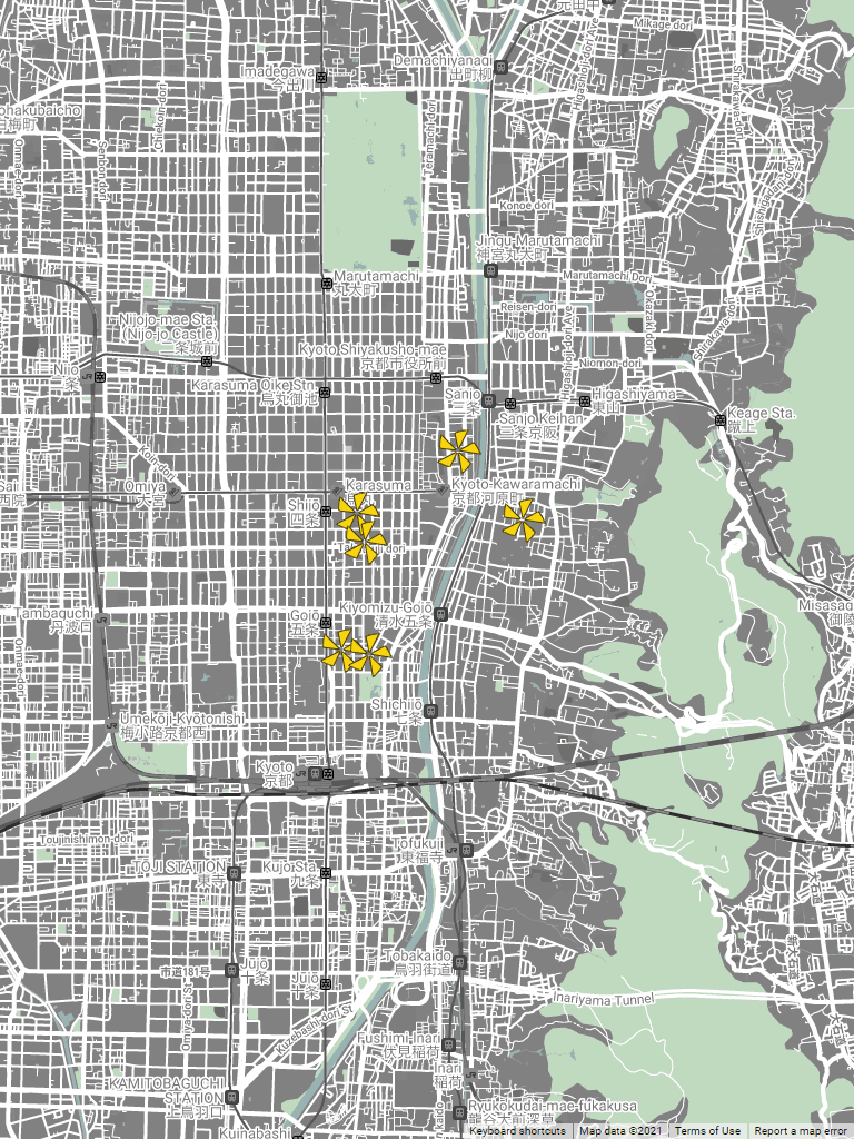 Several asterisks in yellow as place markers are shown on a street map where streets are rendered in white and city blocks in gray