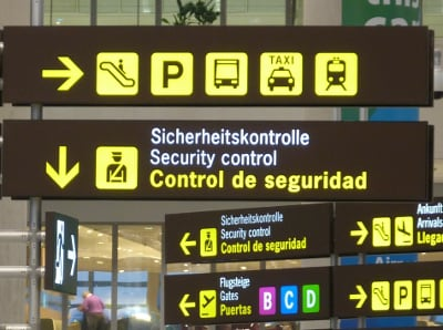 A photo for a board of symbols in a corridor of an airport.