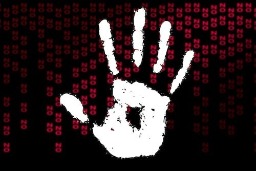 """white stop gesture handprint on a black background with small red letters spelling """"no"""" everywhere"""
