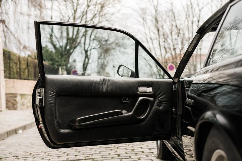 The open door of an old Ferrari
