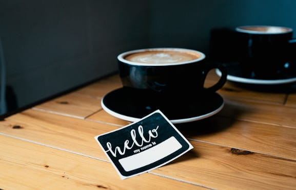 A cup of coffee and a name tag